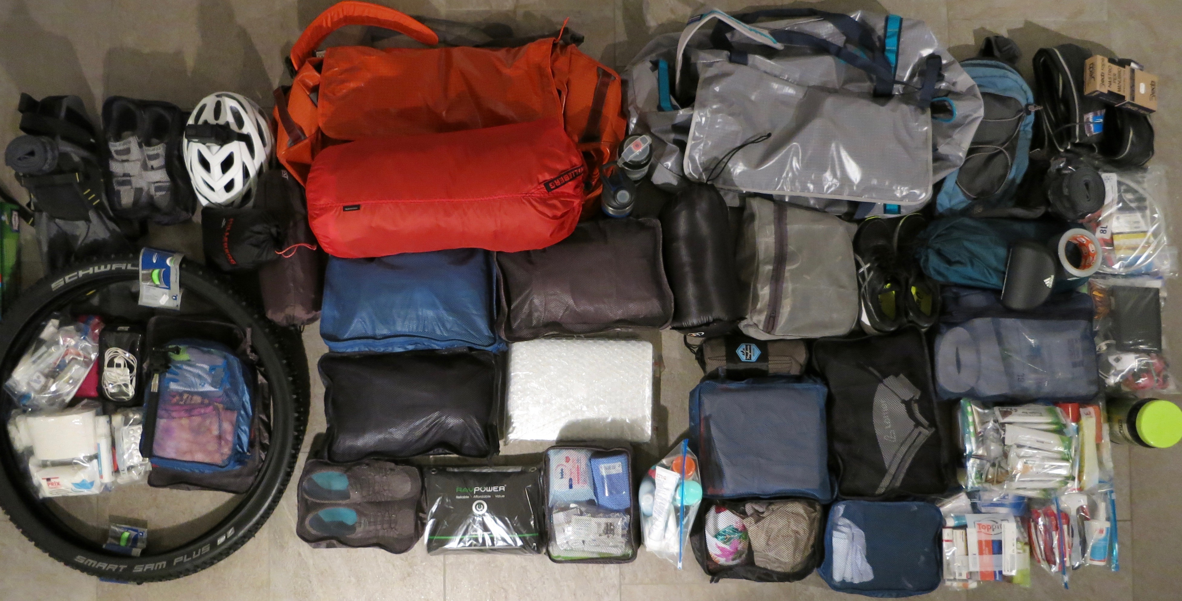 My gear compartmentalized into garment cases and ziploc bags
